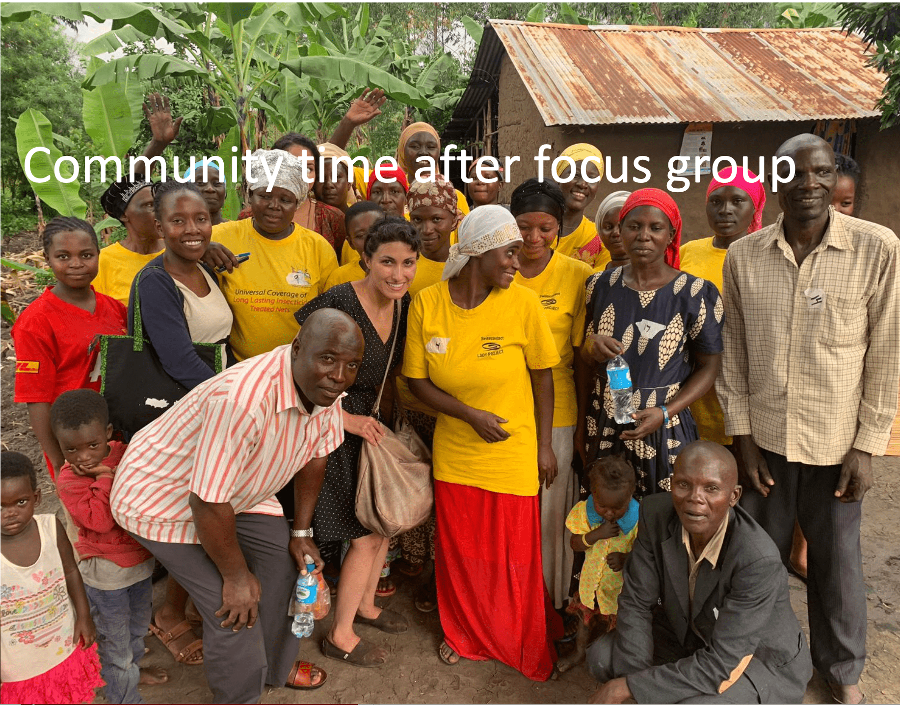 Epidemiologist in Uganda with the community after a focus group