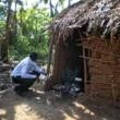 man outside rural dwelling